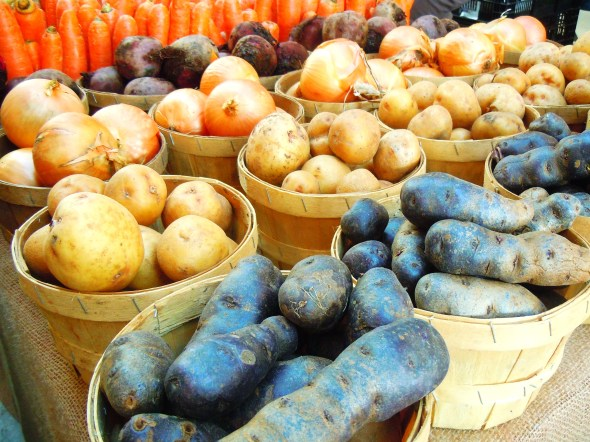 Carrots, potatoes and onions at Wychwood Barns farmers' market